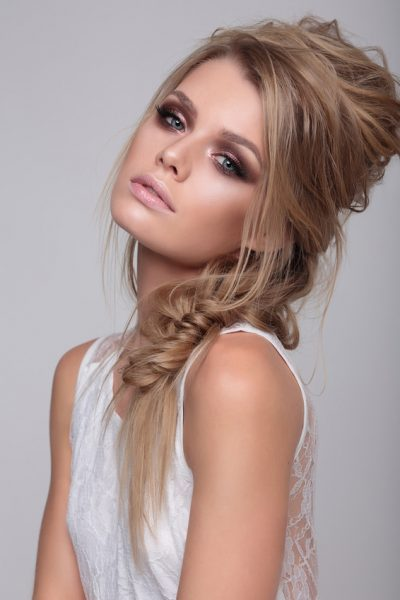 Close-up portrait of young beautiful stylish woman with smoky eyes.